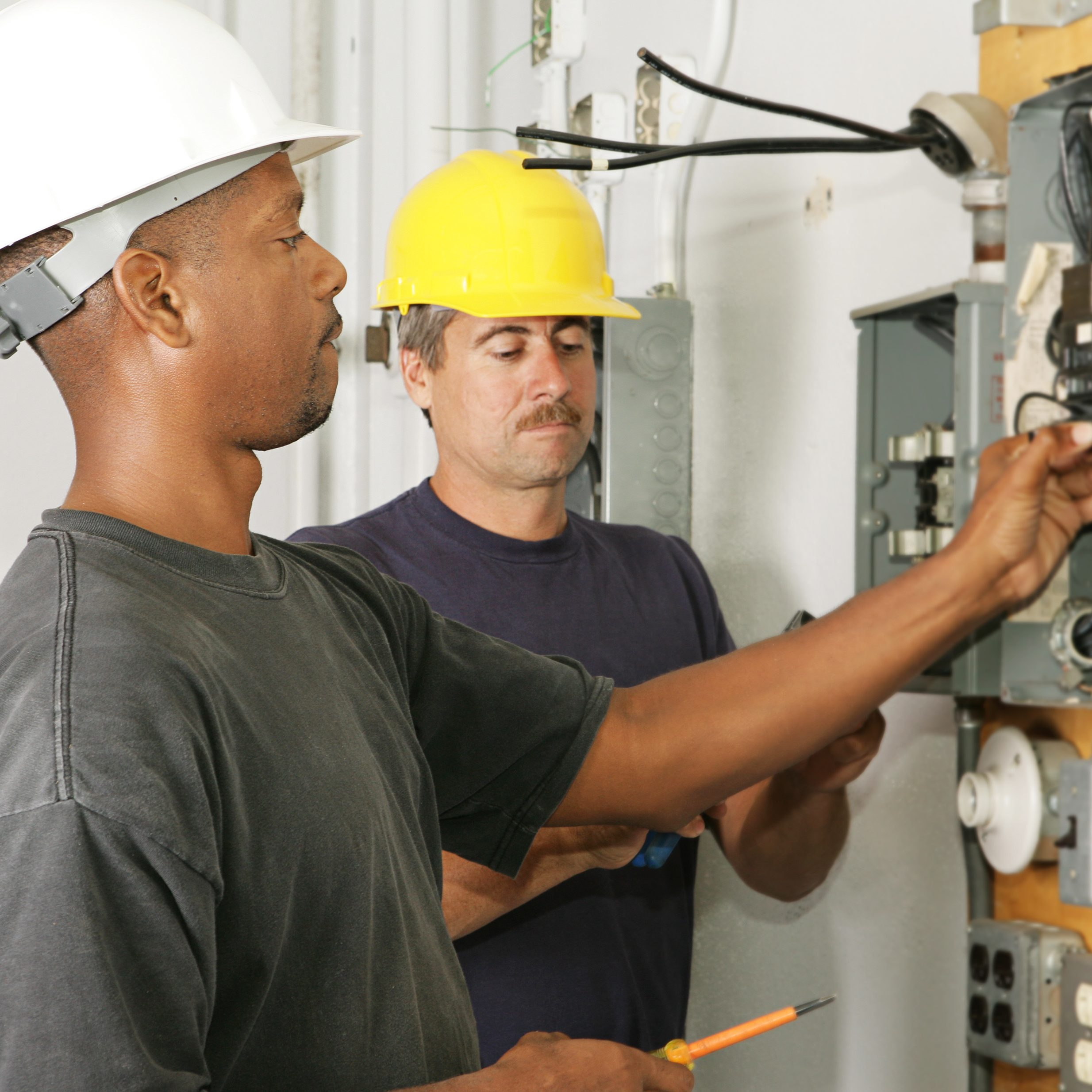 2 Electricians working on an electrical panel